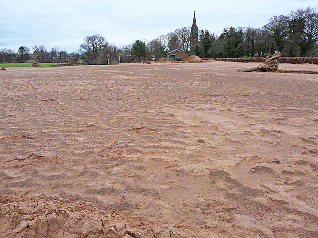 An expanse of sand deposited by floodwater