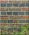 SP9699 : Bench mark, railway bridge east of Wakerley by Alan Murray-Rust