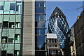 TQ3380 : The Gherkin seen between offices opposite Fenchurch Street station by David Martin
