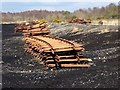N1621 : Rails stacked beside the peatland light railway by Oliver Dixon