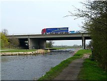 SE3724 : The M62 motorway crossing the Aire & Calder Navigation by Graham Hogg
