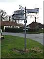 TM1551 : Roadsign on Main Road by Adrian Cable