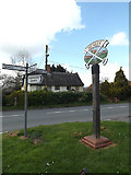 TM1551 : Roadsign & Henley Village sign by Geographer
