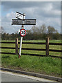 TM1553 : Roadsign on Main Road by Adrian Cable