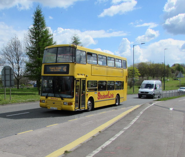 Yellow double-decker bus enters Filton from Stoke Gifford