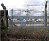 TQ0975 : British Airways aeroplane hiding behind the fence by Andrew Tatlow
