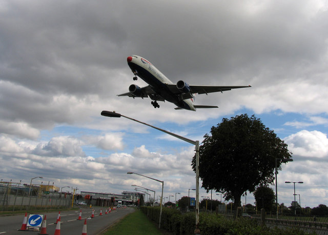 Red Nosed British Airways Boeing 777-200ER over Southern Perimeter Road