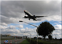 TQ0975 : Red Nosed British Airways Boeing 777-200ER over Southern Perimeter Road by Andrew Tatlow