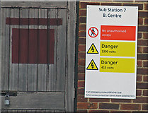 TQ0975 : Signs on Sub Station 7 by Andrew Tatlow