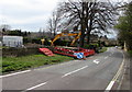 SP1037 : L Lynch excavator at the edge of High Street, Broadway by Jaggery