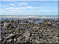 SN5068 : Low tide on the foreshore at Llansantffraed by John Lucas