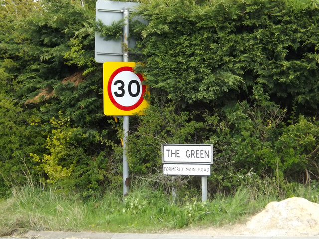 Roadsign & The Green sign