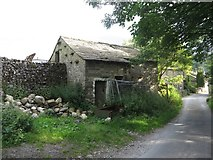 SD9772 : Disused shed, Kettlewell by Graham Robson
