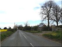 TM1551 : Main Road & footpath by Geographer