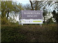 TM1651 : Manor Farm sign by Geographer