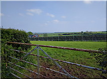 SS9907 : Solar panels in a field at Sunnyburrow Farm by Rob Purvis