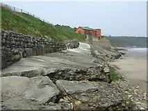 TA0684 : Shattered sea defences, Cayton Bay by JThomas