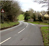 SO8700 : Warning sign - bend in Woefuldane Bottom near Minchinhampton by Jaggery