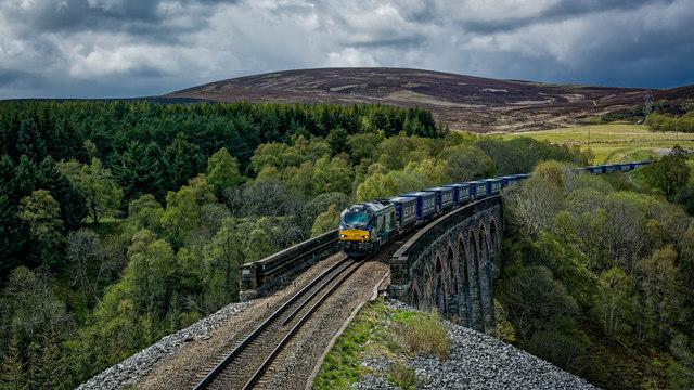 Freight service hauled by loco 68002 (Intrepid) crossing Slochd viaduct