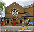 TQ2884 : Chapel and telephone box, Kentish Town by Julian Osley