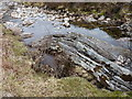 NN0787 : Folded rocks in the burn by Richard Law