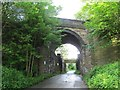 SE2634 : Disused railway bridge over Redcote Lane by Stephen Craven