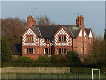 SJ4768 : Ornate brick house in Great Barrow by Dave Dunford
