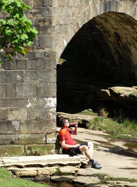 Taking a break by the old bridge