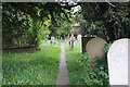 SK2164 : Public footpath through the churchyard of All Saints, Youlgrave by Bill Boaden