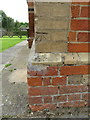 SP6408 : Bench mark on Worminghall Village Hall by John S Turner