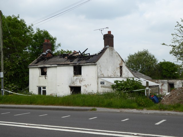 Burnt-out shell of Toll Gate Farm on A5011