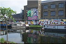 TQ3784 : View of street art on the side of Cofely GDF Suez reflected in the River Lea by Robert Lamb