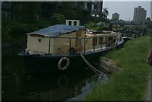 TQ3784 : View of a boat moored on the Hertford Union Canal at the confluence with the River Lea by Robert Lamb