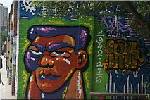 TQ3784 : View of street art commemorating Muhammad Ali's death on the River Lea towpath by Robert Lamb