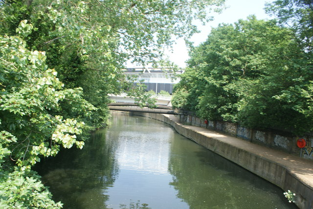 View of the pipes of the Northern Outfall Sewer crossing the River Lea Navigation from the footbridge by Old Ford Lock