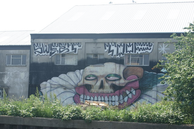 View of Sweet Tooth street art on the rear of a warehouse on the River Lea
