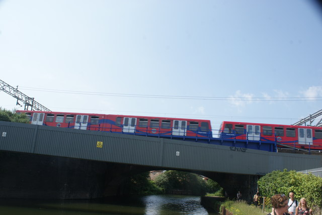 View of a DLR train crossing the River Lea from the River Lea towpath