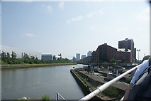 TQ3882 : View along the River Lea from the raised pathway at the confluence with the Limehouse Cut by Robert Lamb