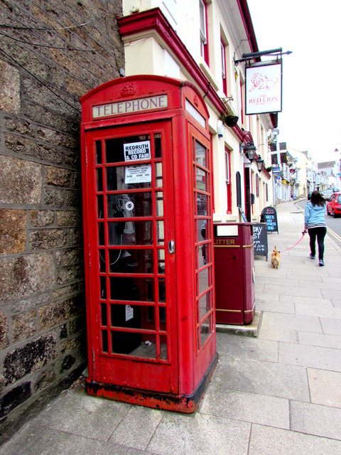 Red phonebox at the edge of the Red Lion, Redruth