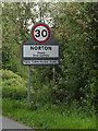 TL9565 : Norton Village Name sign on the A1088 by Adrian Cable