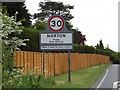 TL9567 : Norton Village Name sign on the A1088 Ixworth Road by Adrian Cable