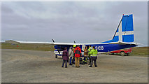 HT9737 : Loading cargo and six passengers, Directflight service, Foula by Julian Paren