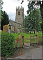 SK7452 : Rolleston: Holy Trinity church and the start of a footpath by John Sutton