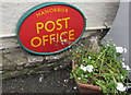 SS0697 : Unusual location for a Post Office name sign, Manorbier by Jaggery