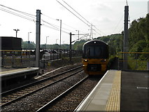 SE2436 : The first scheduled train arrives at Kirkstall Forge station by Rich Tea
