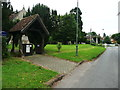 TL1126 : Lychgate and war memorial, West Street, Lilley by Humphrey Bolton