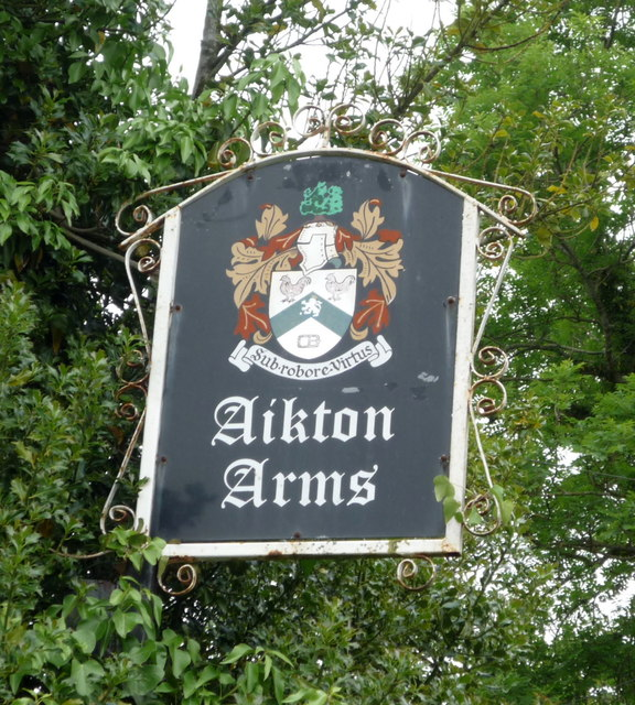 Sign for the Aikton Arms public house