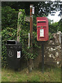 NY1238 : Postbox and signs at Wardhall Cottages by Graham Robson