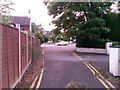 SZ0896 : Northbourne: footpath O22 emerges onto Wimborne Road by Chris Downer