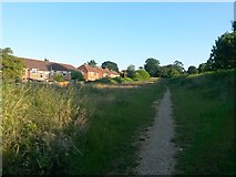 SZ0796 : Kinson: footpath E34 and the back of Aldridge Road houses by Chris Downer